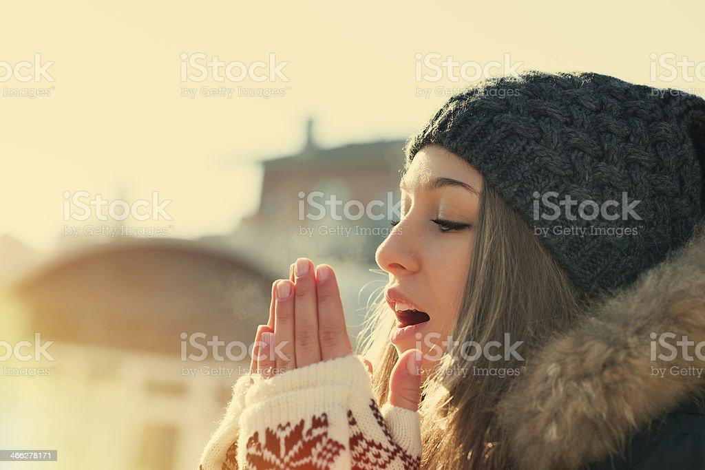 Cute Girl Heating her Hands stock photo