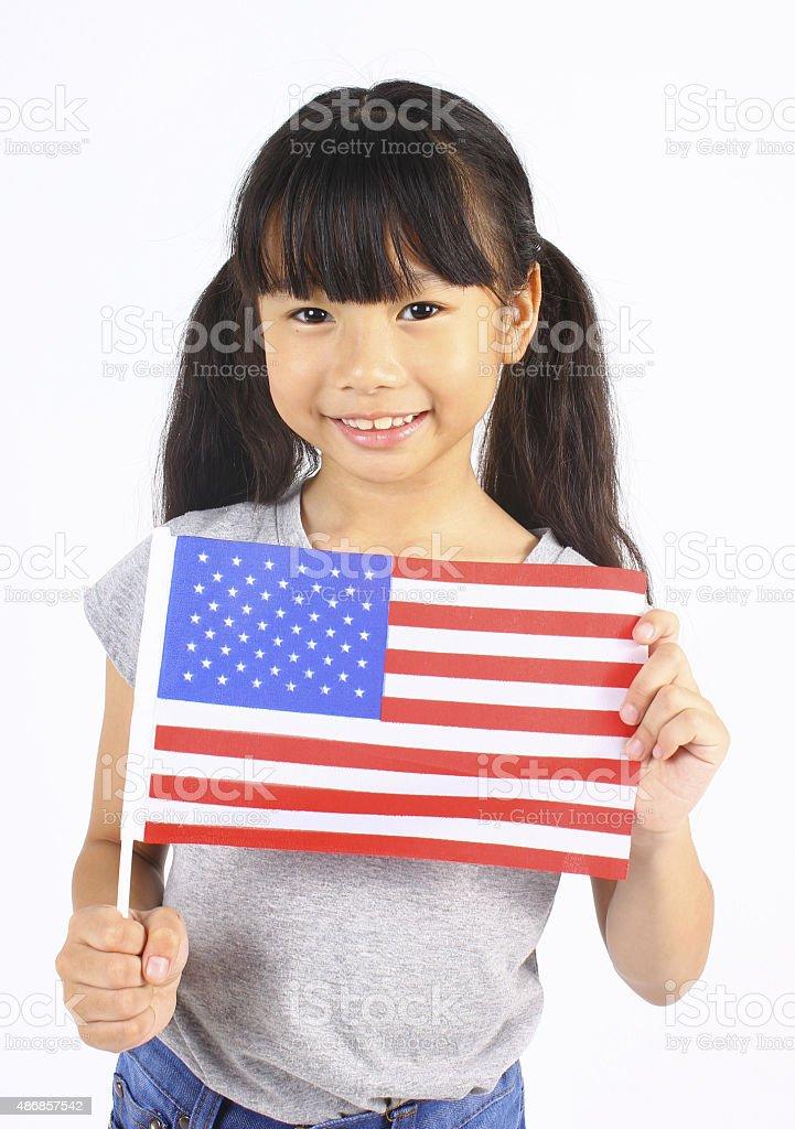 Süßes Mädchen mit eine amerikanische Flagge Lizenzfreies stock-foto