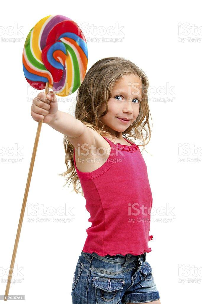 Jolie fille tenant des bonbons stic. photo libre de droits