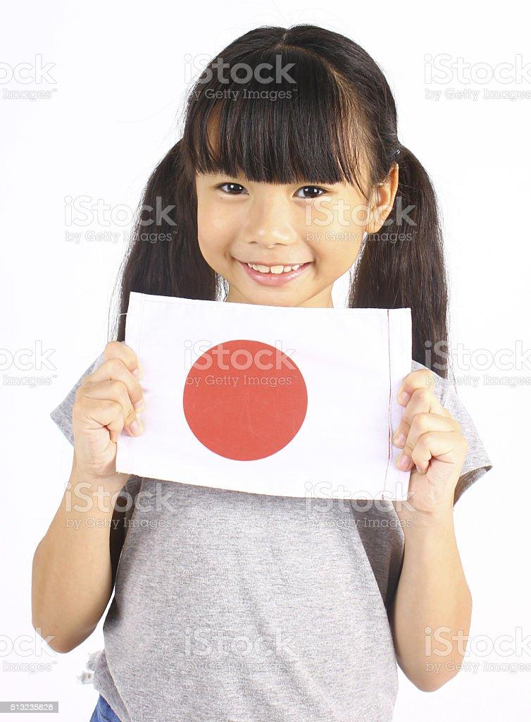 Cute girl holding Japanese Flag stock photo