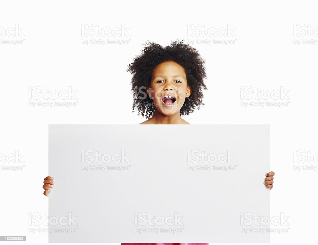 Cute girl holding large billboard against white - copyspace royalty-free stock photo