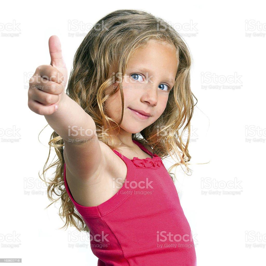Jolie fille tenant Pouce levé photo libre de droits
