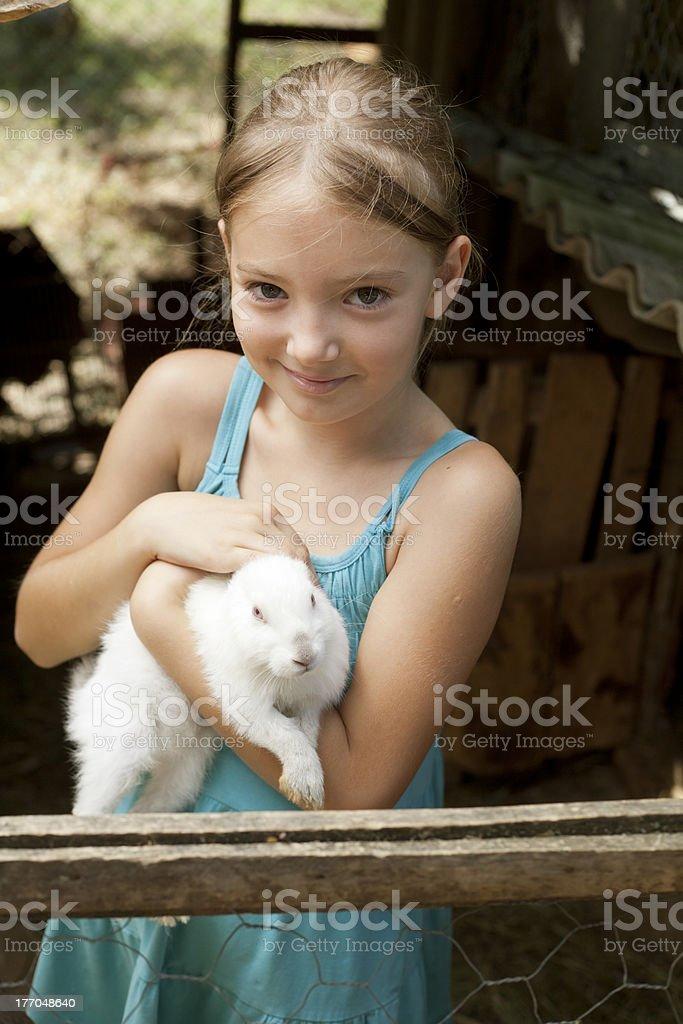 cute girl holding white rabbit royalty-free stock photo
