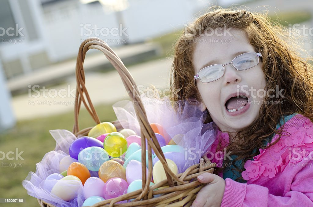 Cute girl holds easter basket royalty-free stock photo