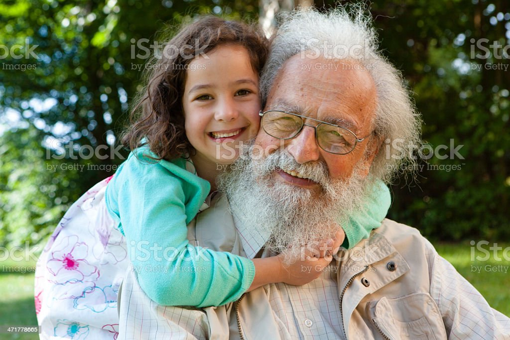 cute girl hugging bearded grandfather royalty-free stock photo