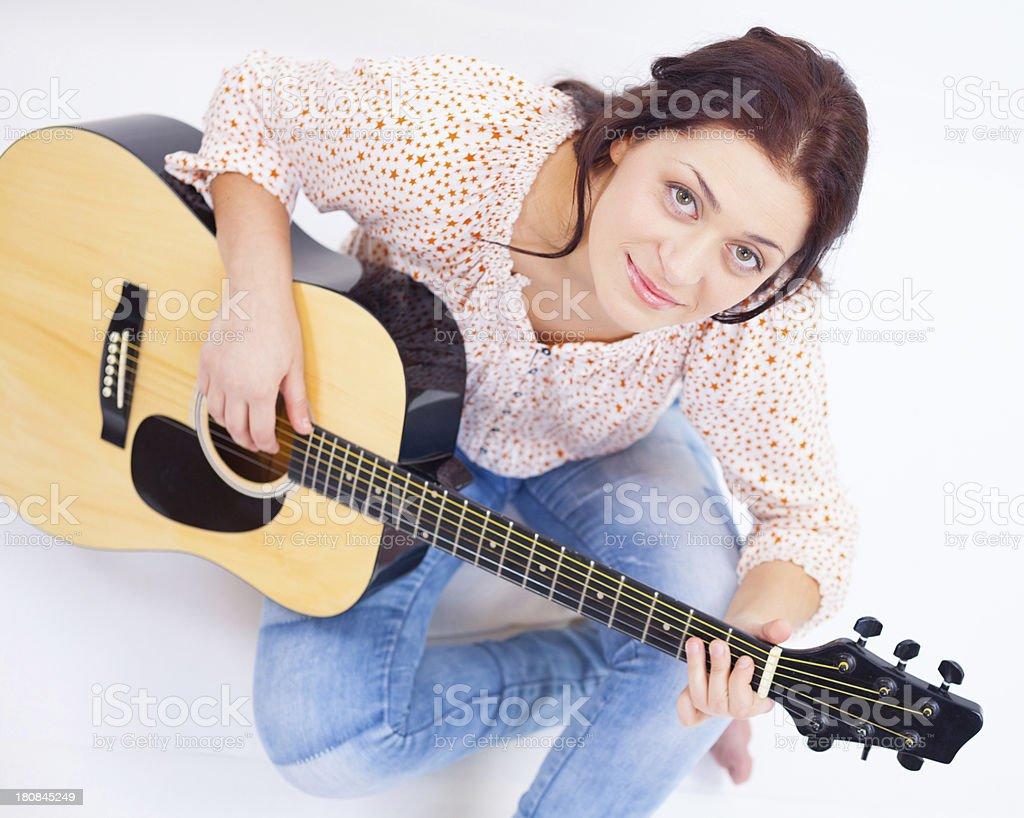 Cute girl hugging guitar royalty-free stock photo