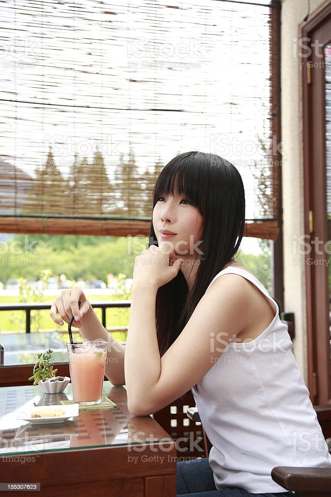 Cute girl in a cafe royalty-free stock photo