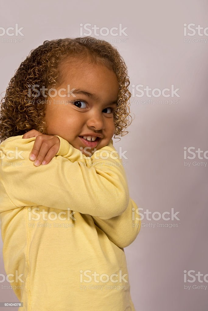 Cute girl in a funny pose stock photo