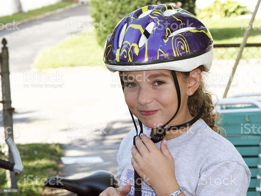 Cute girl in a helmet royalty-free stock photo