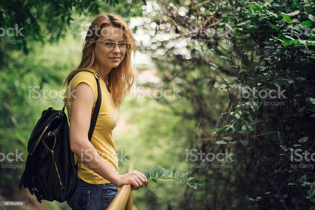 Cute girl in forest stock photo