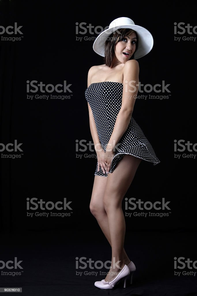 Cute girl in polka dotted dress royalty-free stock photo