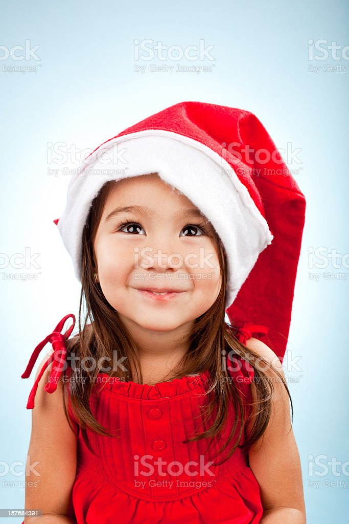 cute girl in santa hat royalty-free stock photo