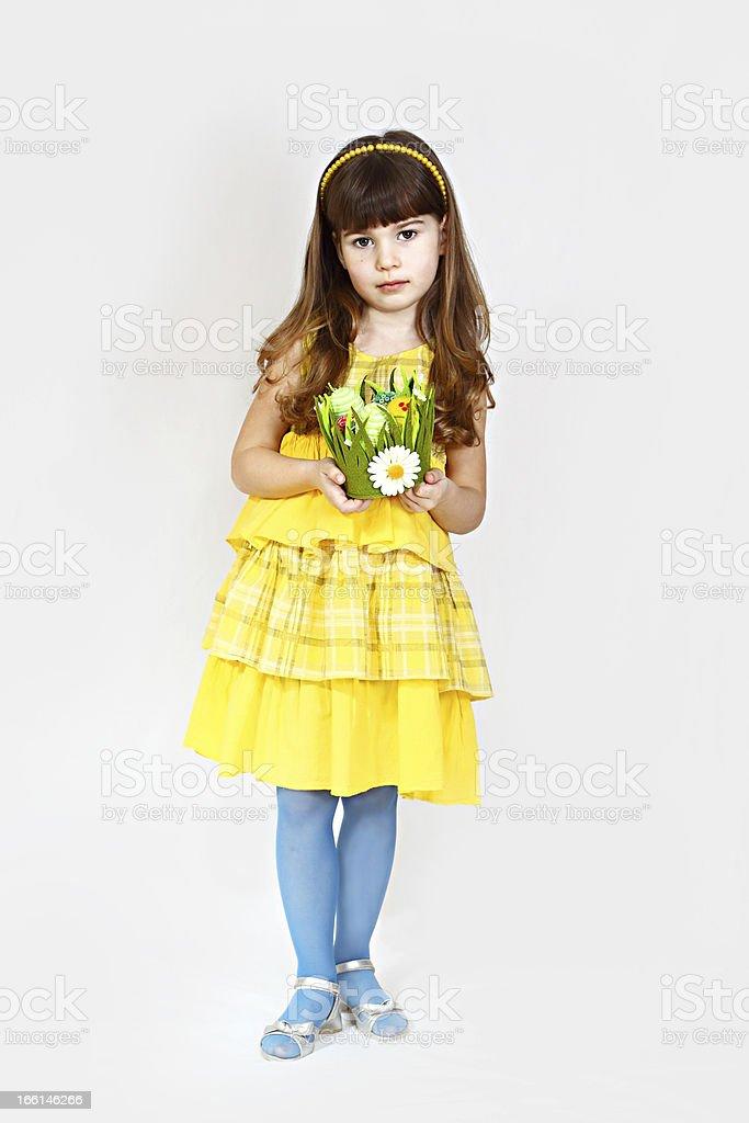 Cute girl in yellow royalty-free stock photo
