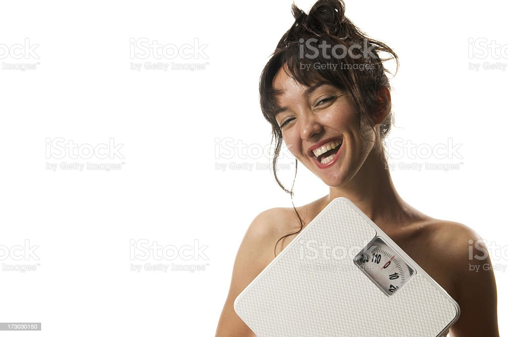 cute girl is holding weight scale royalty-free stock photo