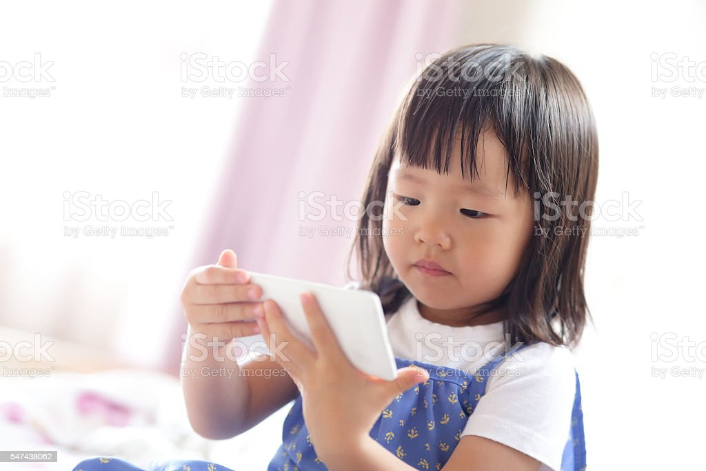 cute girl is looking tablet stock photo