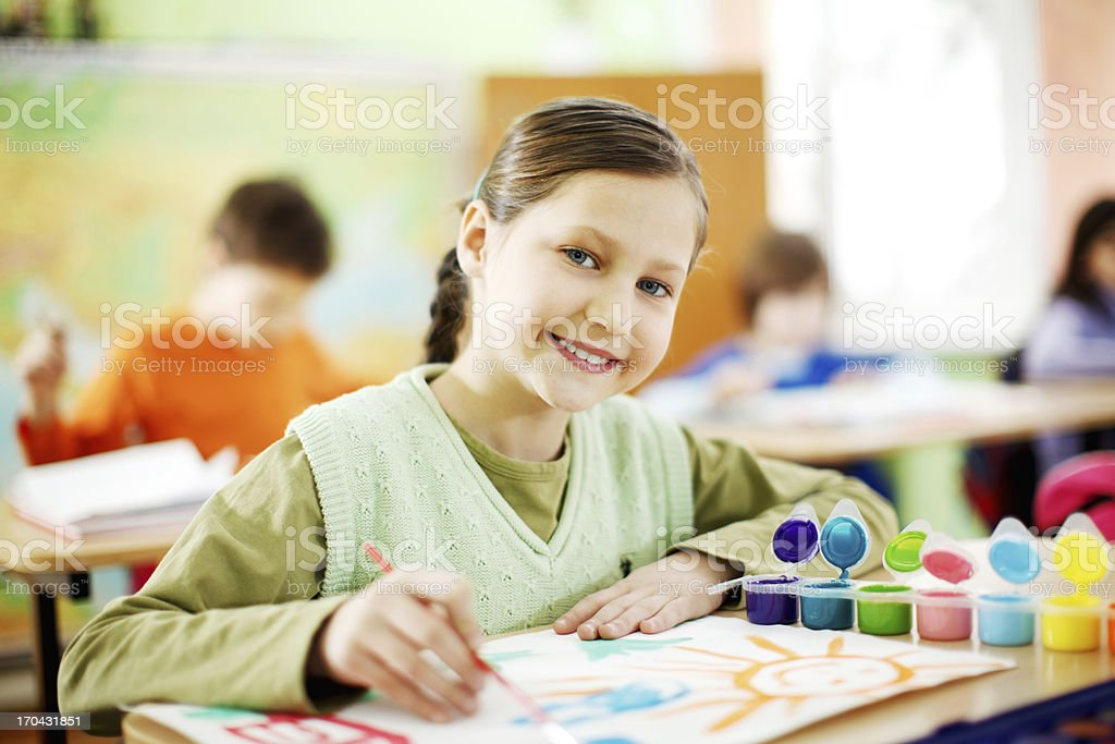 Cute girl is making pictures with watercolors. royalty-free stock photo