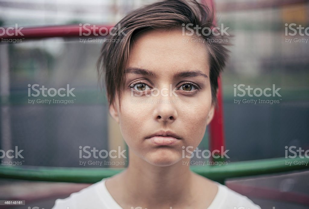 Cute Girl is staring at the camera analyzing you royalty-free stock photo