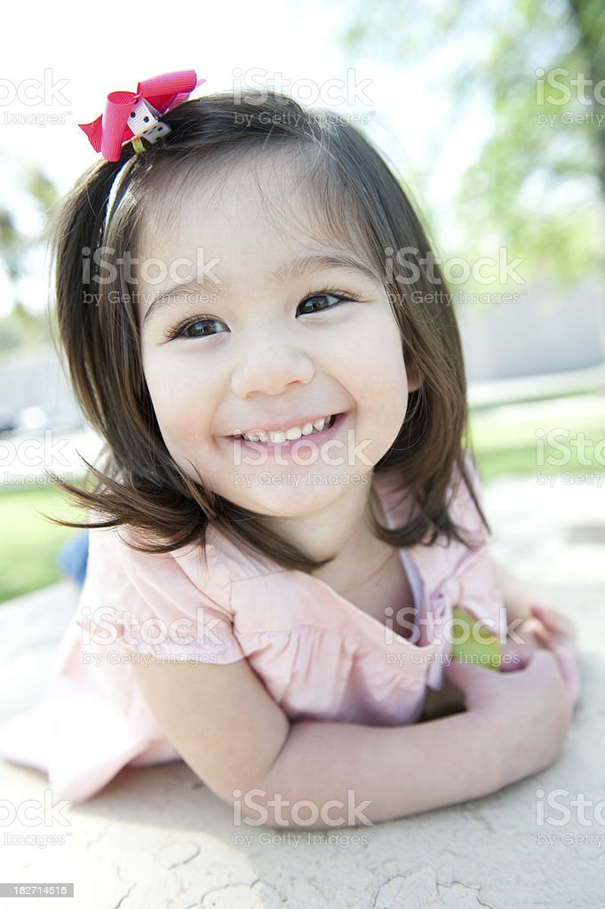 cute girl laying on table royalty-free stock photo