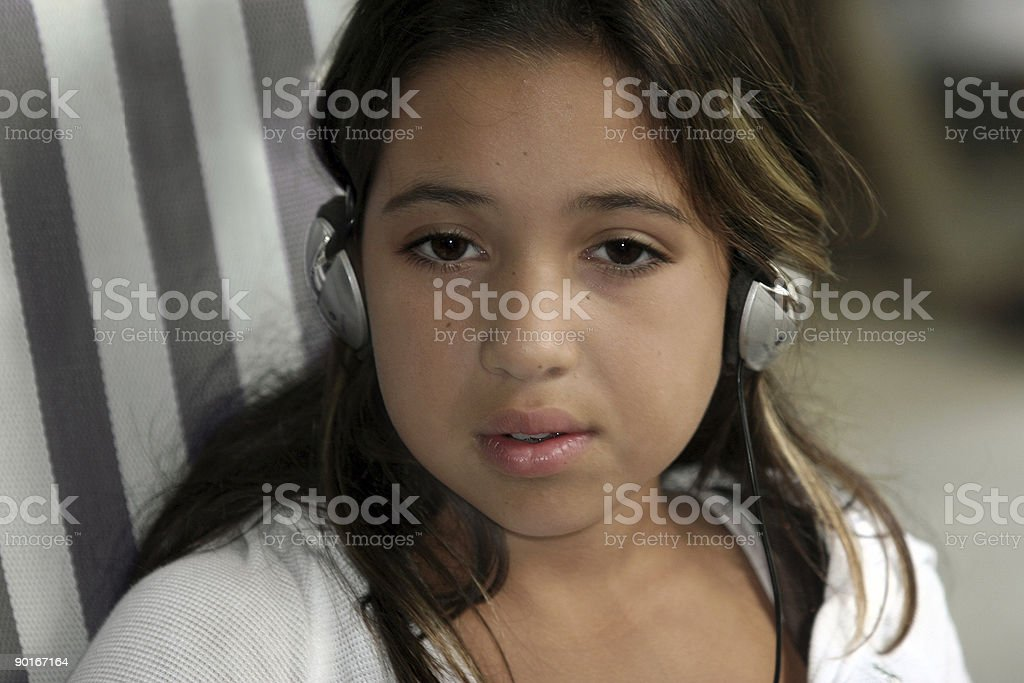 Cute girl listening to music royalty-free stock photo