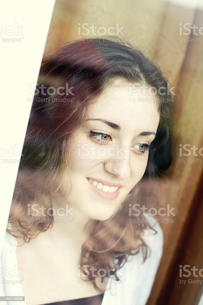 Cute girl looking throught window royalty-free stock photo