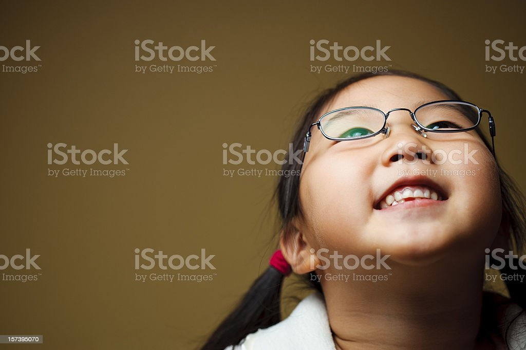 Cute Girl Looking Up and Smiling royalty-free stock photo