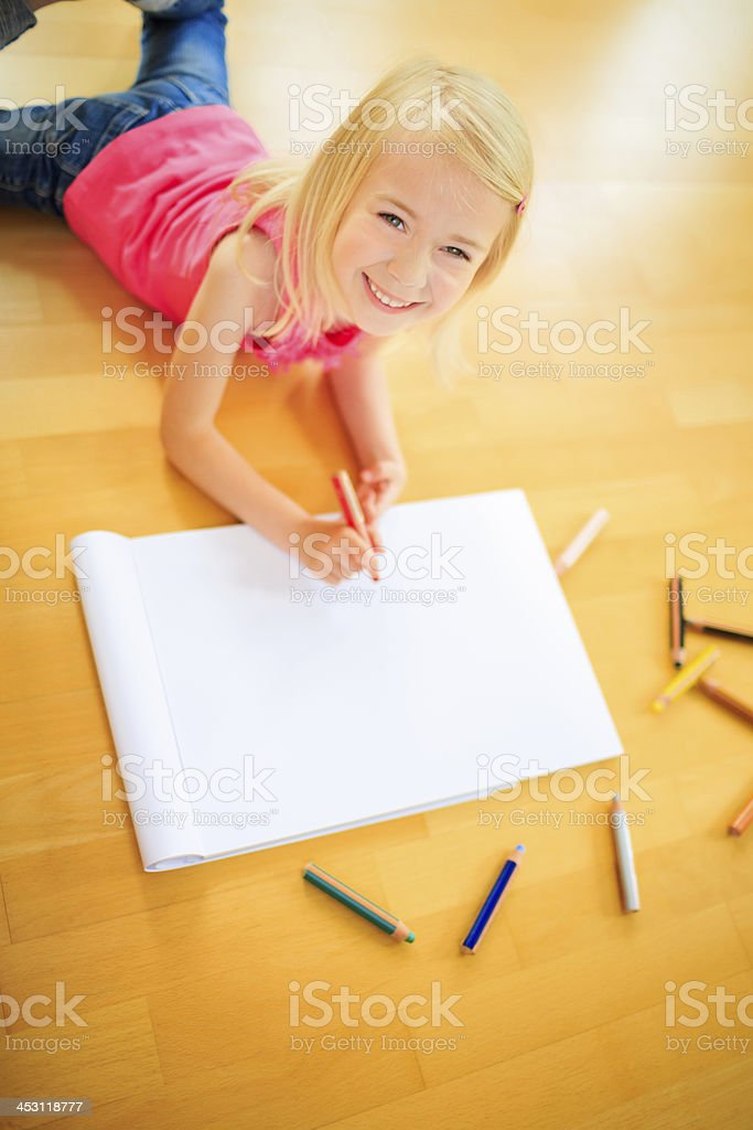 Cute girl looking up from her painting royalty-free stock photo