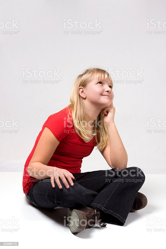 Cute girl looking up stock photo