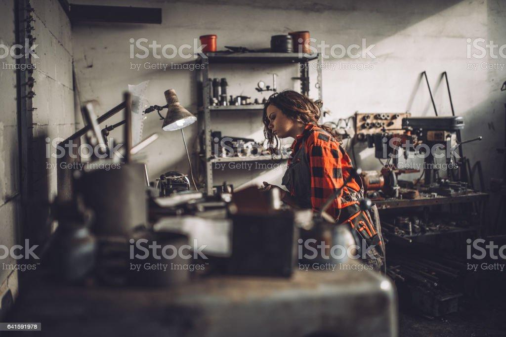 Cute girl mechanic stock photo