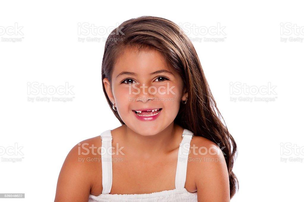 Cute girl missing teeth smiling stock photo