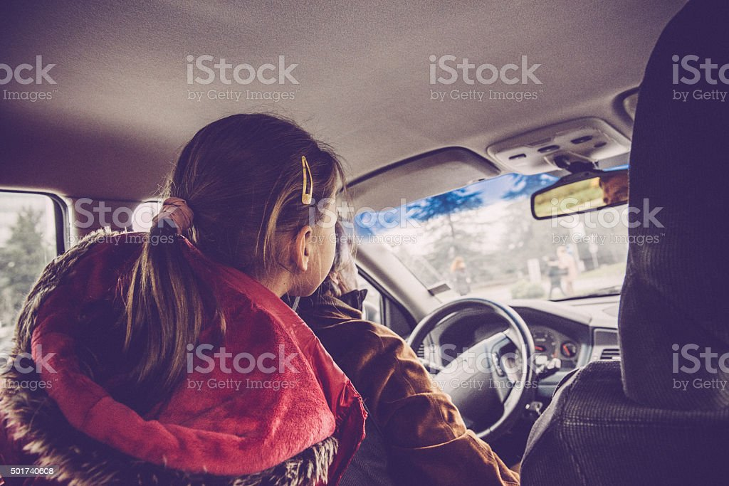 Cute Girl of Five as a Back Seat Traveler stock photo