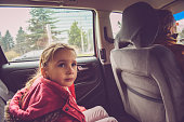 Cute Girl of Five in Pink as Back Seat Traveler
