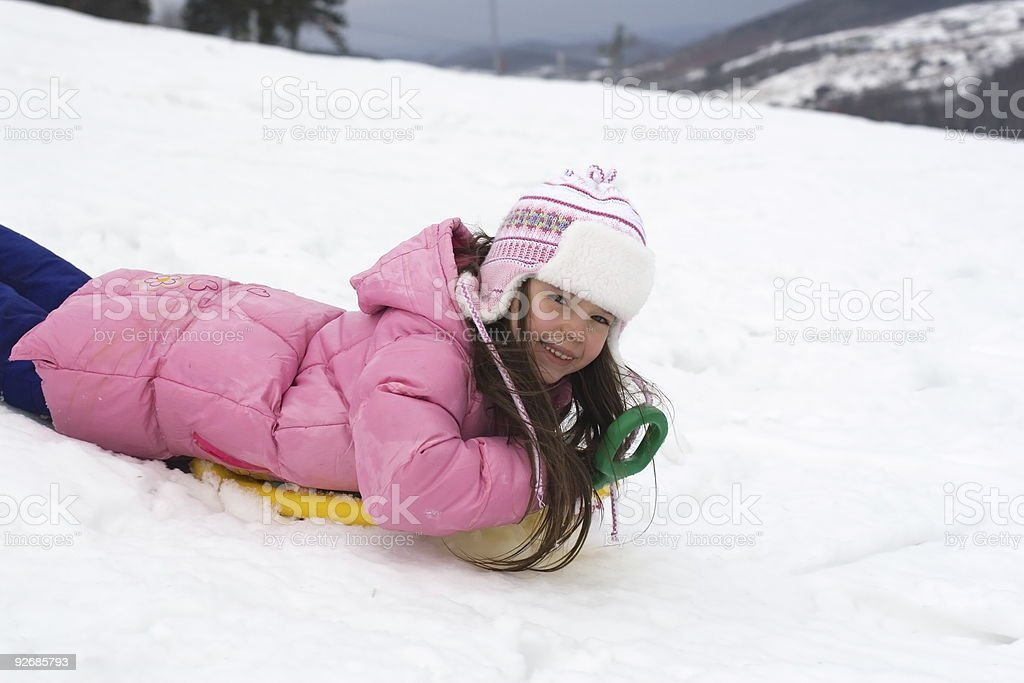Cute Girl on a Snow Sled royalty-free stock photo