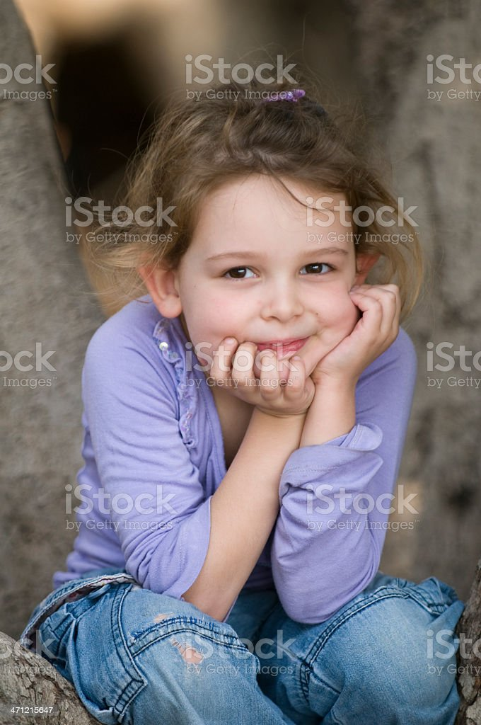 cute girl on a tree royalty-free stock photo