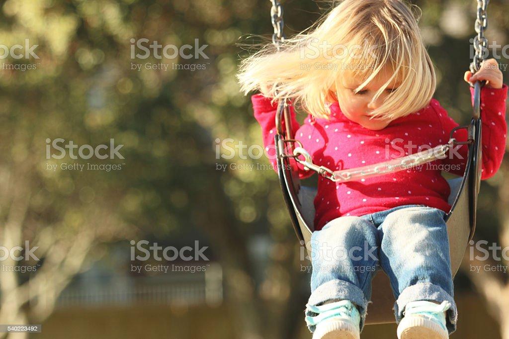 Cute girl on swing stock photo