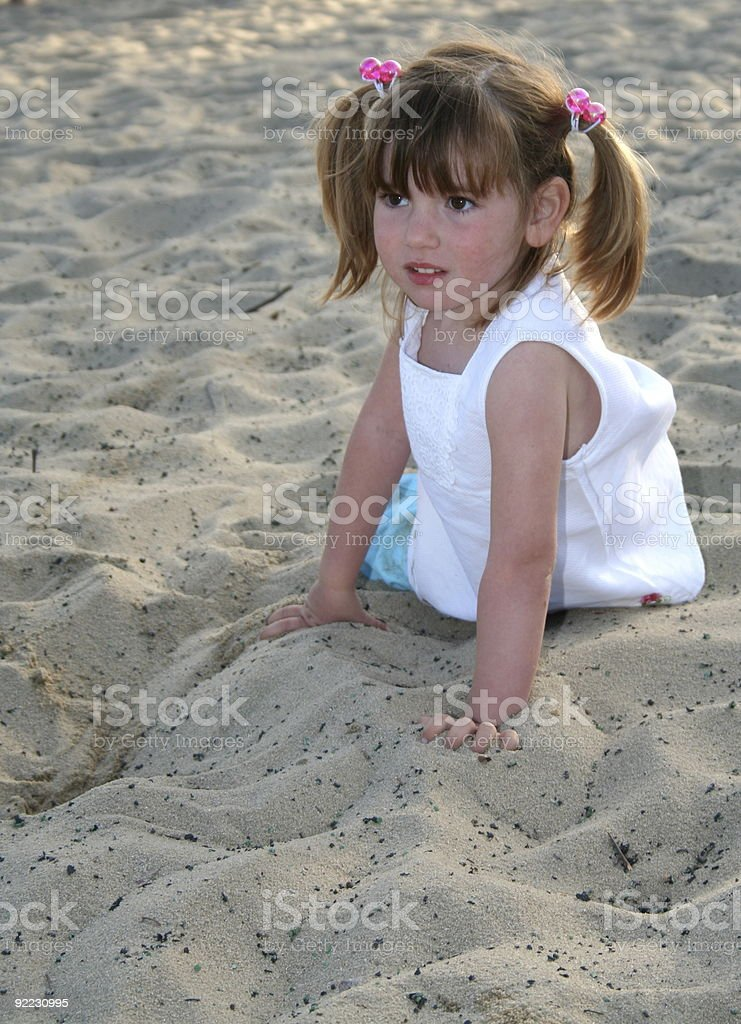 Cute Girl on the Sand royalty-free stock photo