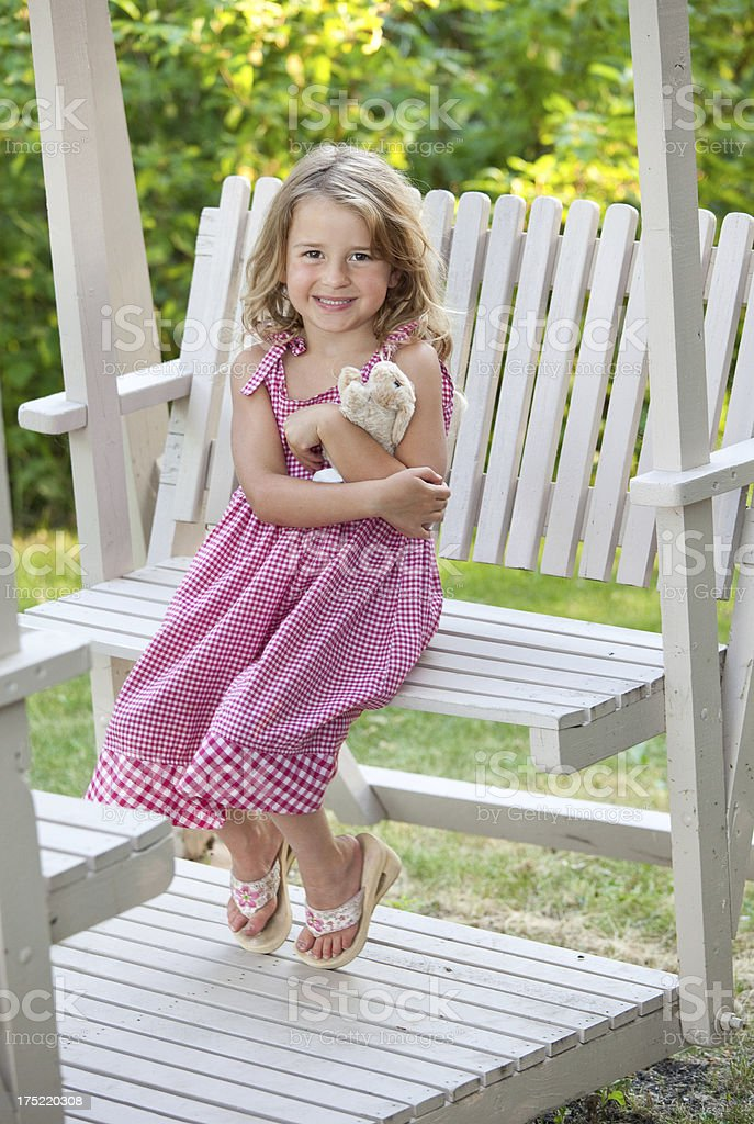 Cute Girl on Wooden Swing royalty-free stock photo