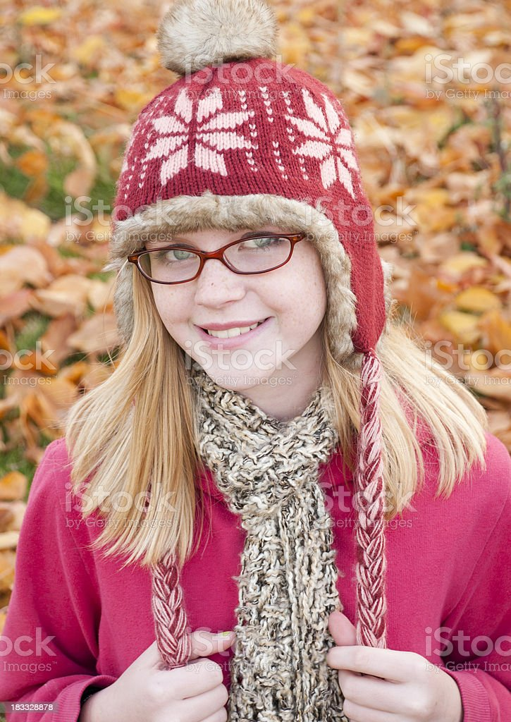 Cute girl outdoors with a hat and scarf royalty-free stock photo
