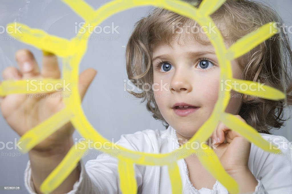 Cute girl painting sun royalty-free stock photo