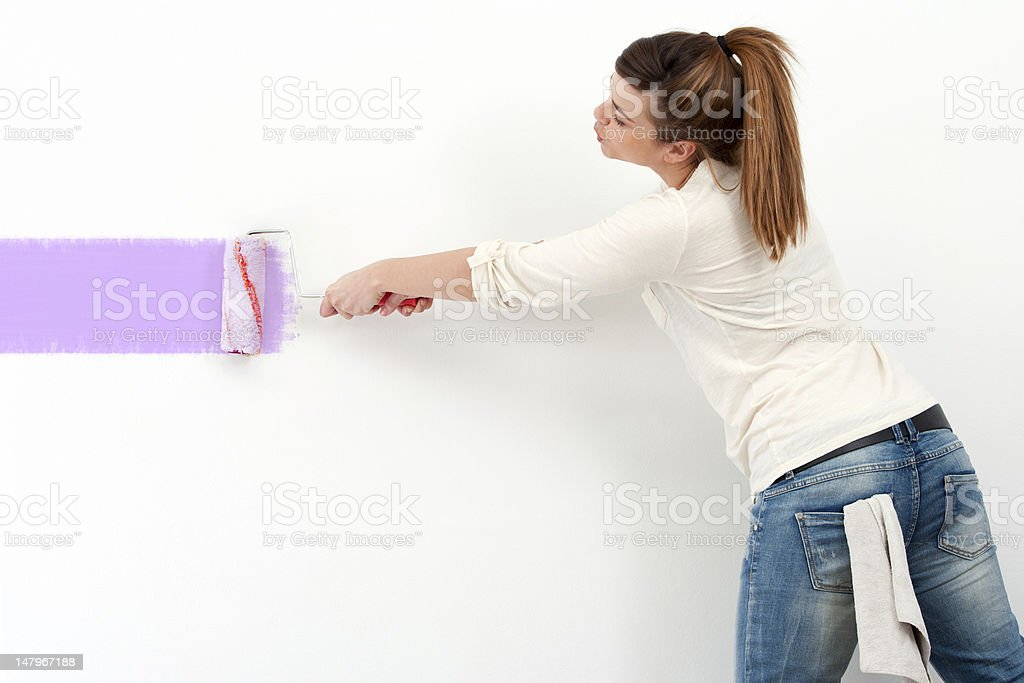 Cute girl painting the wall. royalty-free stock photo
