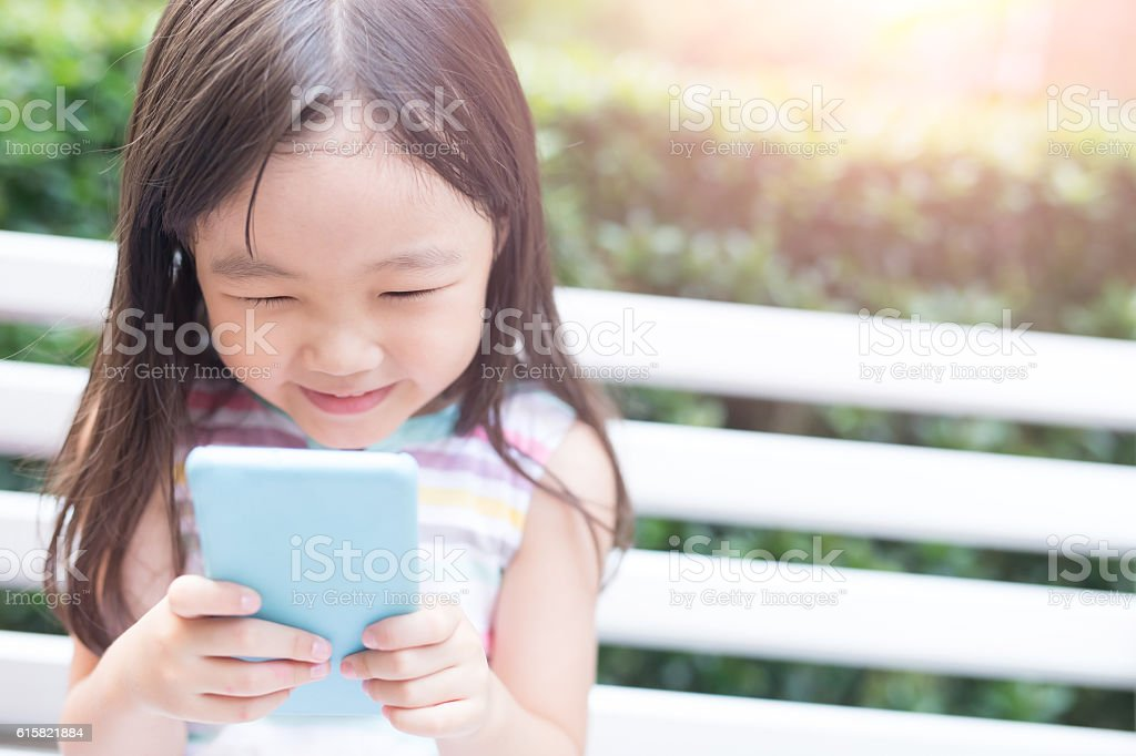 cute girl play phone stock photo