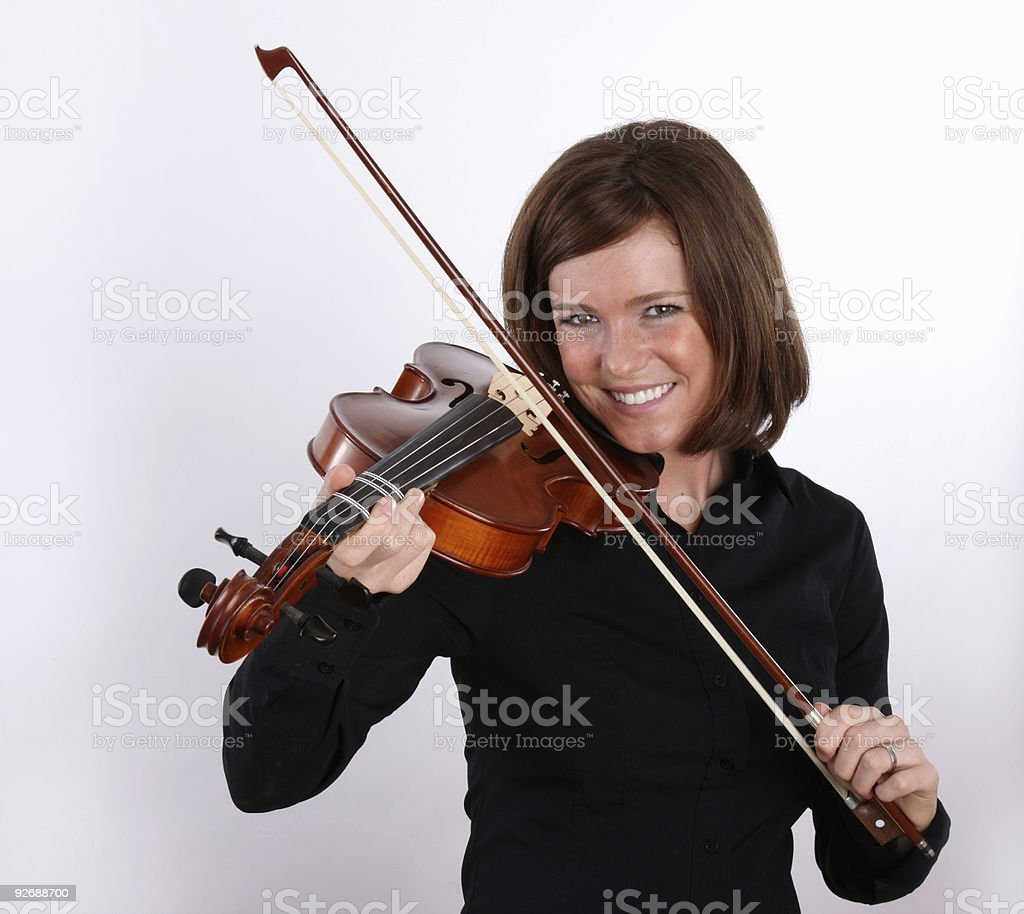 Cute girl playing the violin royalty-free stock photo