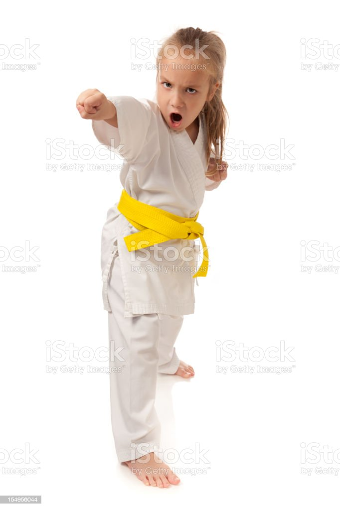 Cute girl practicing karate (martial arts) royalty-free stock photo