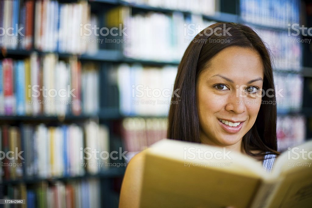 cute girl reading at the library royalty-free stock photo