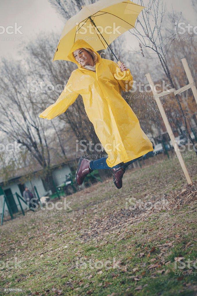 Cute girl ready for the rain! stock photo