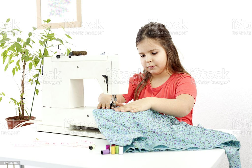 cute girl sewing royalty-free stock photo