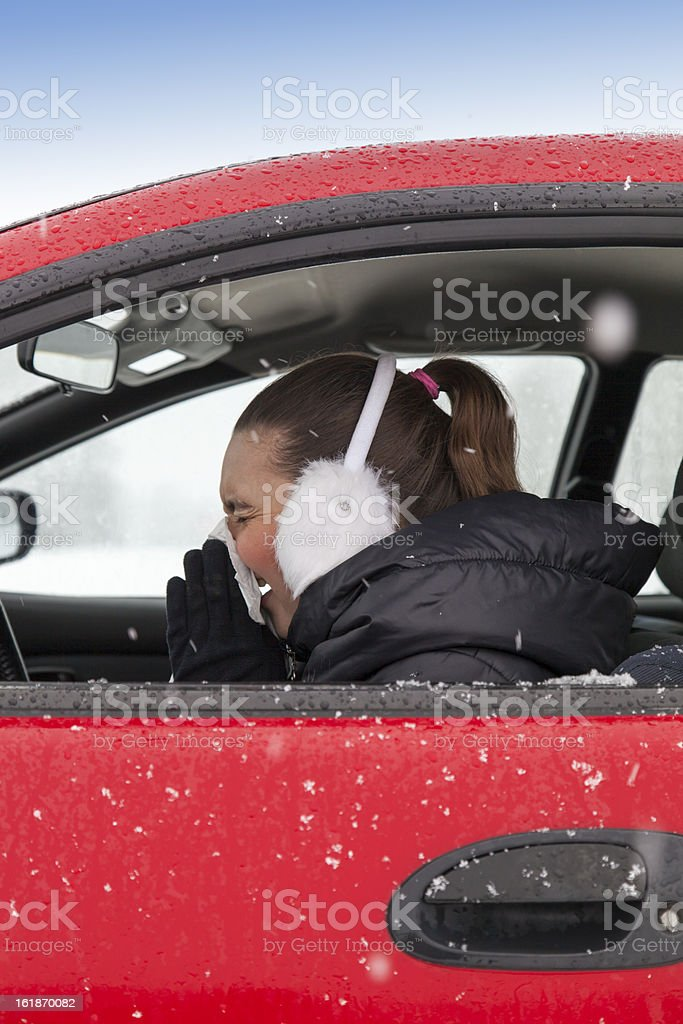 Cute girl sneezes in a car royalty-free stock photo