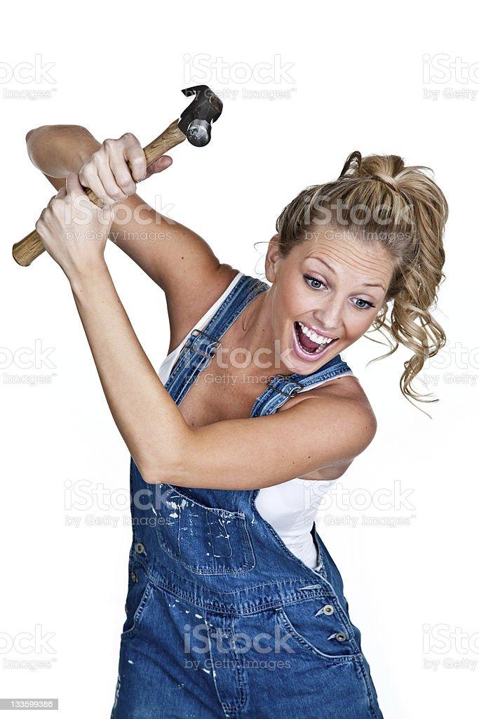 Cute girl swinging a hammer royalty-free stock photo