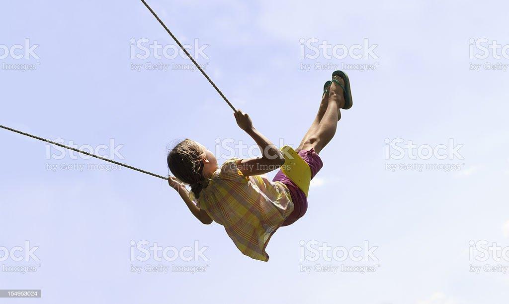 Cute Girl Swinging High stock photo