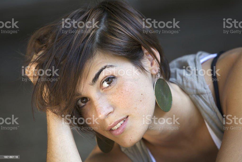 Cute girl touching hair stock photo