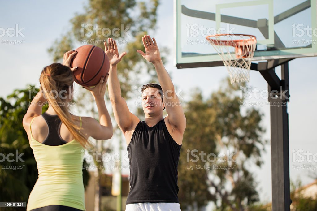 Cute girl trying to score some points stock photo